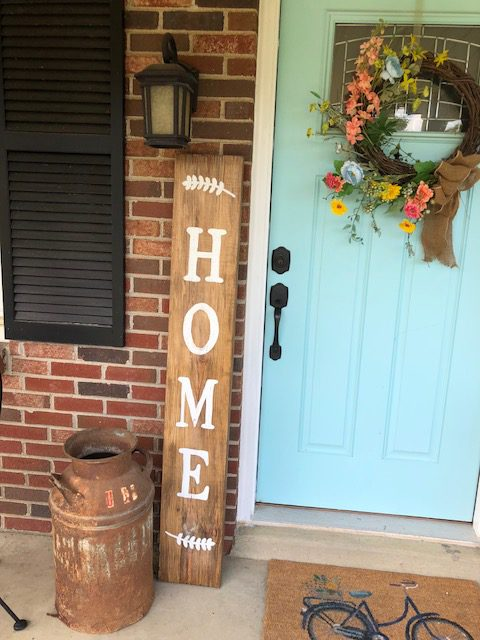 Decorating your front porch is a great way to welcome guests in. It's also the first thing you see when you pull in the drive. So, why not make it pretty with a DIY front porch home sign. I'll show you how to make one under $10!